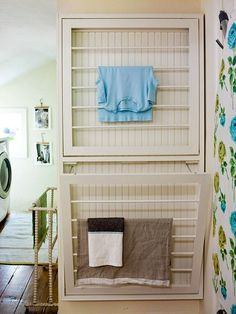 Small-Space Laundry Center  Squeezing a washing machine and dryer into any available space is a common occurrence in many homes, but what about the rest of the laundry room supplies? Add fold-out drying racks to a wall to save space while still getting all the function required of a laundry center.