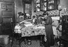 Family of Mrs. Mette making flowers in a very dirty tenement.  New York, New York, 1911