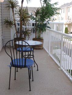 Duradek Grey outdoor vinyl flooring protects and beautifies this