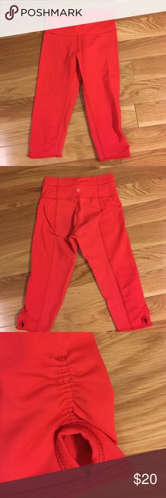 Lululemon cropped size 2 leggings These super cute, size two cropped leggings from LuluLemon are fabulous.  Has a small keyhole accent near each knee cap.  No waist pocket like most leggings have letting you know in case that is a deal breaker. Seamline down back of legs. lululemon athletica Pants Leggings