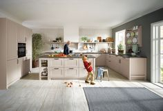 Bring all generations together with family friendly kitchens from Schüller | Canto Sand Grey Satin Kitchen Cupboards/Doors