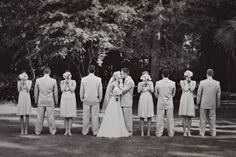 how sweet - it may be cute too, to have the bridesmaids peek around their bouquets and look at the bride & groom.