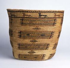"Skokomish (Twana) Basket with Dog | ca. 1910 Skokomish women of the late 19th and early 20th centuries are renowned as the weavers of fine, soft-twined storage and burden baskets embellished with often-complex geometric designs in reddish-brown and black on a neutral grass ground. Vertically-stacked repeating designs like this one are frequently seen, produced in a technique known as overlay twining, and have been identified as ""boxes"" or ""fishnets"" by the weavers themselves."
