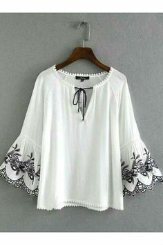 White informal blouse with black string tie and black embroidered bell sleeve cuff