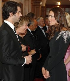 Always one step ahead: As appropriate as ever, Kate had her dress hand-stitched with silver beading to represent New Zealand's national embl...