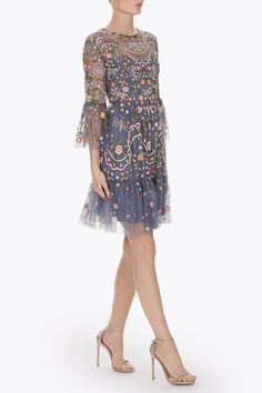 Actress and style icon Sarah Jessica Parker is a fan of Needle & Thread's exquisitely decorated dresses. Part of the label's Spring '17 collection, this design is cut from storm-blue tulle with hand-sewn beading and threadwork depicting dragonflies and flowers. It's finished with fluted sleeves and a tonal crepe de chine slip for smoothness and opacity.
