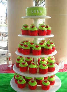 Watermelon Cupcake Tower Red cake with chocolate chip (seeds). Watermelon flavored fondant topper. Buttercream smash.