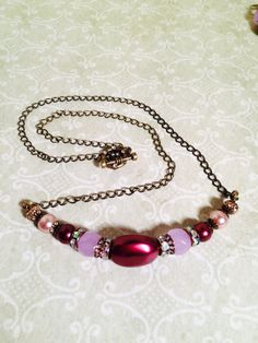 A personal favorite from my Etsy shop https://www.etsy.com/listing/232777470/special-daywine-and-pink-glass-pearls