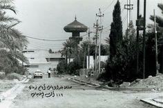 من مراحل تبليط شوارع منطقة الحارثية عام 1983