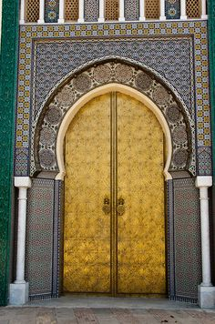 Doors, royal palace that is still in use by the royal family of Morocco. Fez. Morocco. By Christopher Rose