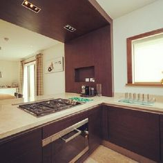 Would you live here?    Kitchen with brown wood fittings.    #StJohnsWood, #London    #Property #RealEstate
