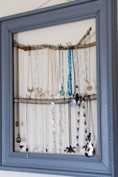 Picture frame with twigs for hanging earrings!