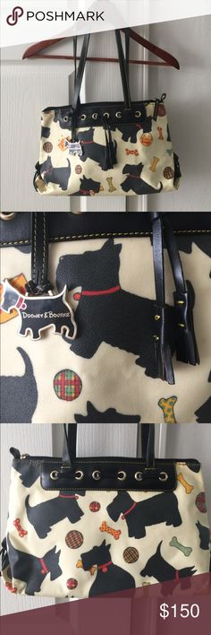 "‼️LRG Dooney & Bourke Scottie Dog Bag. Dooney & Bourke Scottie Dog Bag. Large size. Hard to find. Zipper in perfect working order.  Leather tassels on front along with D&B dog hang tag. This bag has an Interior water stain, shown in pics. Has leather loops for crossbody strap (not included). Shoulder drop is approx 10.5"". Height approx 8.5"" coated canvas with leather trim. Dust bag not included. Dooney & Bourke Bags Shoulder Bags"
