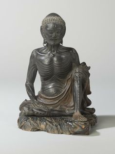 Ascetic Sakyamuni - Wood with pigmented lacquer, inlaid crystal, metal -   16th century.  Momoyama Period.