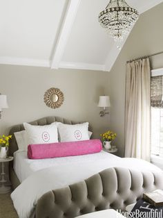 BED ROOM @Andrea Granados  Designer Kelie Grosso envisioned the master bedroom as a soft, platinum respite, but she couldn't resist punching it up with a vibrant dose of color, a hot pink bolster pillow.