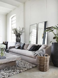 Mirrors behind the sofa make a space feel bigger