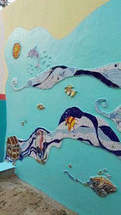 Ricardo Stefani y Julia Gurwicz realizaron este mural llamado Un Mar de Juegos. En el Jardín de infantes integral n 1 Alfredo Palacios.