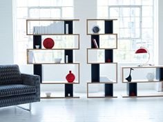 Content by Conran Counter Balance Shelving and 59th Street Armchair