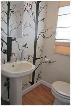 Minimalist tree mural with colored birds... maybe in color block style?