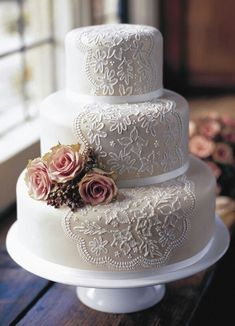 One hundred percent elegant, these lacy, beaded, and beribboned wedding cakes are as pretty as the brides whose receptions they grace. #weddingideas