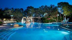 The Ol' Man Island pool area at Disney's Port Orleans Resort – Riverside lit up at night