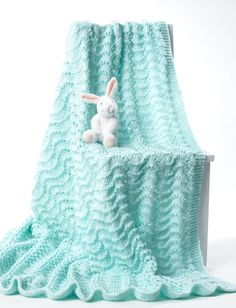 Knit Baby Blanket in Bernat Softee Baby Solids. Discover more Patterns by Bernat at LoveKnitting. The world's largest range of knitting supplies - we stock patterns, yarn, needles and books from all of your favorite brands.