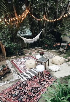 Moroccan party decor bohemian backyard party hammock outdoor rugs poufs
