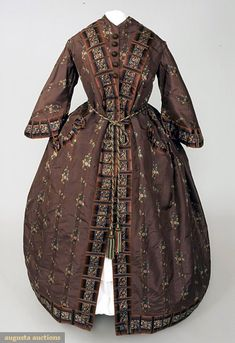 Brown ribbed silk brocade wrapper with pink lining and cord and tassel belt, 1850s.