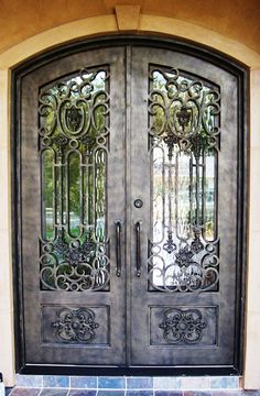Lerida: 106-5 - Cantera Doors & Iron entry doors on display in our showroom in Houston Texas ... Pezcame.Com