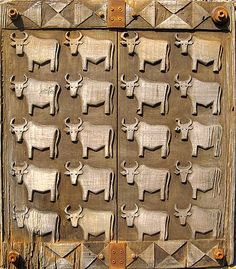 """Door with carved cows by Robyn Gordon, South Africa. (Photo Links to """"Cows for Lobola"""" Behind this door lives a twenty cow wife, maybe? Porte Cochere, Entrance Doors, Doorway, Door Detail, Knobs And Knockers, Unique Doors, Closed Doors, Stairways, Windows And Doors"""
