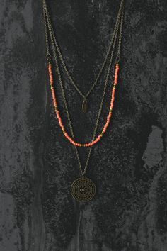 Welcome to Ananke Jewelry! This is a handmade boho / hippie style layered (multi strand) necklace. Looks great with a smily face :) Antique brass
