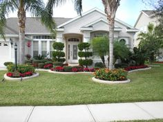 Cheap Landscaping Ideas For Front Yard Front yard landscape plans with red flowers and trees plus beautiful white house.Front yard landscape plans with red flowers and trees plus beautiful white house. Tropical Landscaping, Porch Landscaping, Garden Design, Front Yard Landscaping Design, Home Landscaping, Front Garden, Texas Landscaping, Residential Landscaping, Garden Planning
