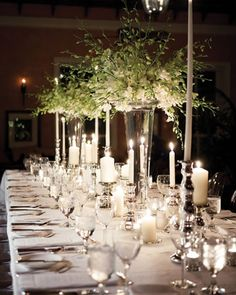 Tall, white taper candles and silver urns filled with dendrobium orchids create sophisticated centerpieces, via Martha Stewart Weddings. White Centerpiece, Candle Centerpieces, Wedding Centerpieces, Centerpiece Ideas, Wedding Table Arrangements, Inexpensive Centerpieces, Hanging Centerpiece, Hanging Candles, Martha Stewart Weddings