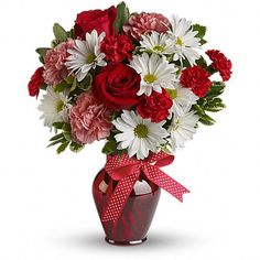 Hugs and Kisses Bouquet with Red Roses - Best Romantic Gift Ideas Forever  Price:  US$35.99  Delight your love with this beautiful bouquet of bright white chrysanthemums, precious pink carnations, romantic red roses and more in a radiant red vase.