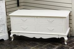 Lane cedar chest with drawer painted in white with slight distressing. Peacock Lane Home Decor, 615 High Street., Worthington, OH. 43085, 10:00 a.m - 5:00pm, 7 days a week.