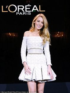 Blake Lively made her big comeback as the face of L'Oreal in Paris Tuesday by flaunting her pins in a white mini-dress