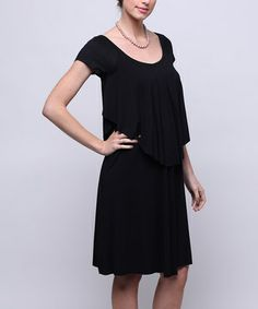 This fashionable frock is the perfect blend of comfort and class, serving as a stylish staple for maternity months and beyond. To nurse, simply lift the top layer and access the openings.