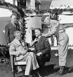 President Franklin Delano Roosevelt presenting the Medal of Honor, to General William Wilbur, as Generals George Marshall and George Patton look on. The event took place in Casablanca on January 22, 1943.