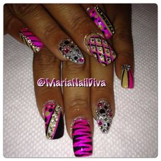 Stiletto Nails on ring fingers by: Maria Nail Diva of Baton Rouge