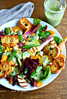 Summer salads don't get more textural and sassy than this easy Griddled Bread & Halloumi Salad with Green Tahini Dressing. The dressing is also a sauce and dip, so drizzle it on roasted vegetables, dip into with crudités, dunk fresh bread in it, stir into grains or just drink it out of the jar!