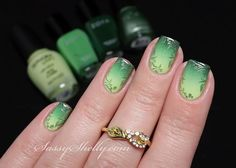 Emerald colored Ombre nail art with leaves as accent. A wonderful and magical looking nail art design that makes use of green hues and leaf designs to make a truly astounding forest effect.