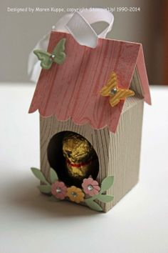 Inspiration only-- use milk carton box template (see 3d things to cut board) with a folded piece of card for roof......EASY! bunny in house hutch choc favour gift favour treat spring easter
