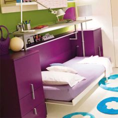 Bed folds into desk! So cool.