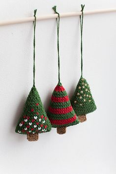 This set includes 3 pcs of unique handmade ornaments. There are little Christmas trees of different styles: one with golden beads (on one side, the other is in plain green), one with red and whites hearts (on one side, the other is in plain green) and one with red stripes. Each