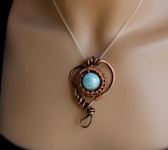 I like big cloudy aquamarines.  (This one is 14mm.)  They look like miniature planets. Recycled copper.