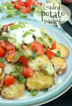 Loaded potato nachos with guacamole, sour cream, spring onions, tomatoes and plenty of cheese - a real crowd-pleaser!