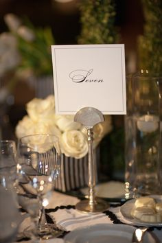 We enjoyed planning this classic and elegant wedding held at The Langham Huntington, Pasadena for our couple, Noelle and Matt. Guests entered to a beautiful arrangement on wrought-iron created by Mark's Garden on top of the place card table. The center of the table featured a tall tabletop arrangement with calla lilies and roses.