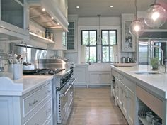 jane Green's kitchen.  Martha Stewart Bedford Grey on Cabs, honed carrerra marble