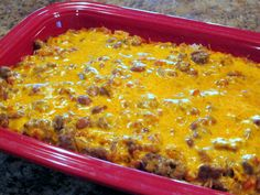 Easy Mexican Casserole -- ground beef, ranch style beans, tortilla chips, rotel tomatoes, onion, cheddar cheese, taco seasoning, cream of chicken soup, water, sour cream and salsa for serving