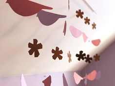 Simple, Sweet Paper Mobile >> http://blog.diynetwork.com/maderemade/how-to/make-a-pretty-diy-paper-mobile?soc=pinterest
